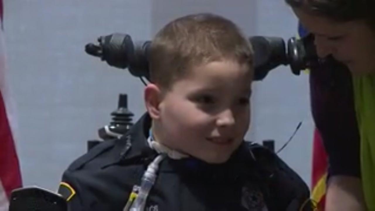 Police swear in a 10-year-old boy with a rare disorder as a junior police officer