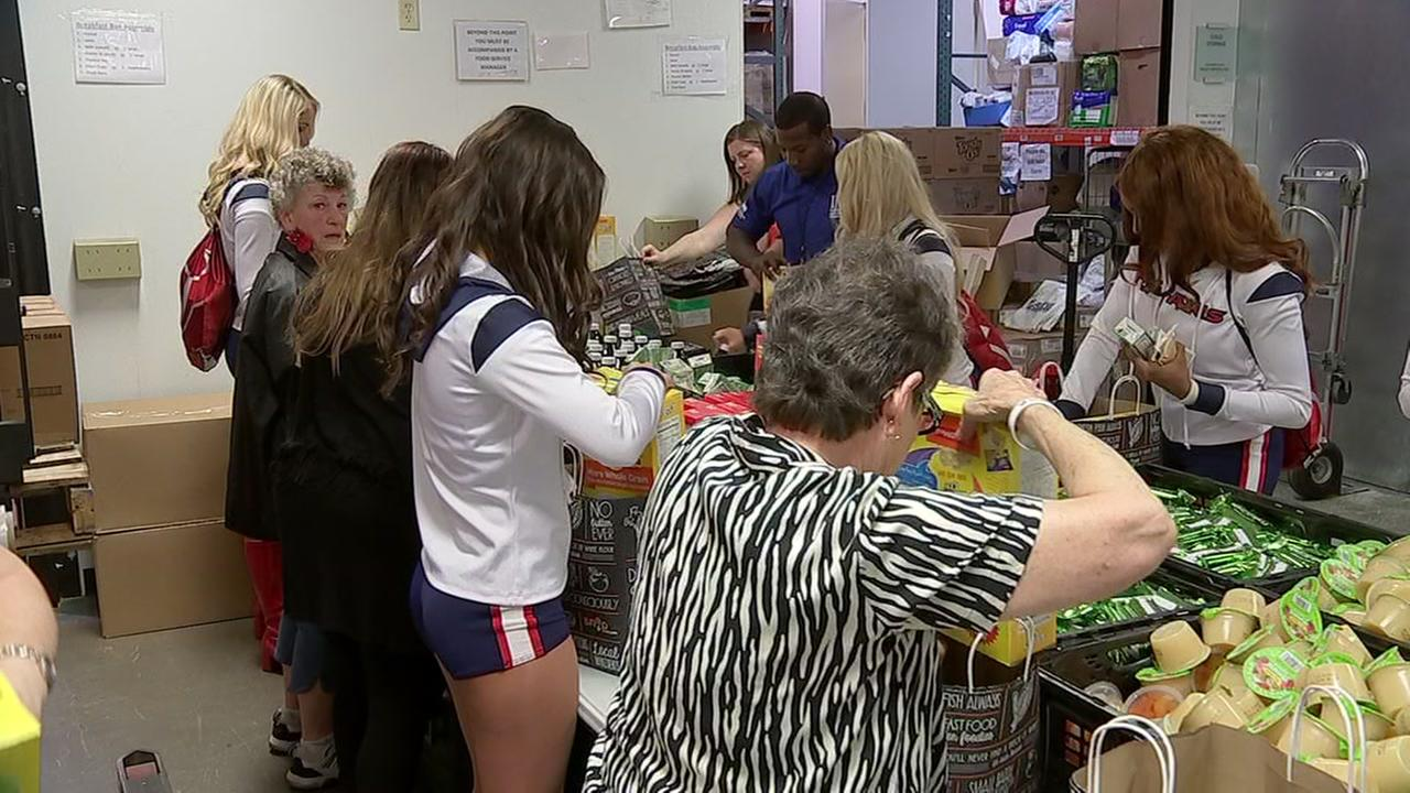 Texans cheerleaders deliver food to seniors with Meals on Wheels