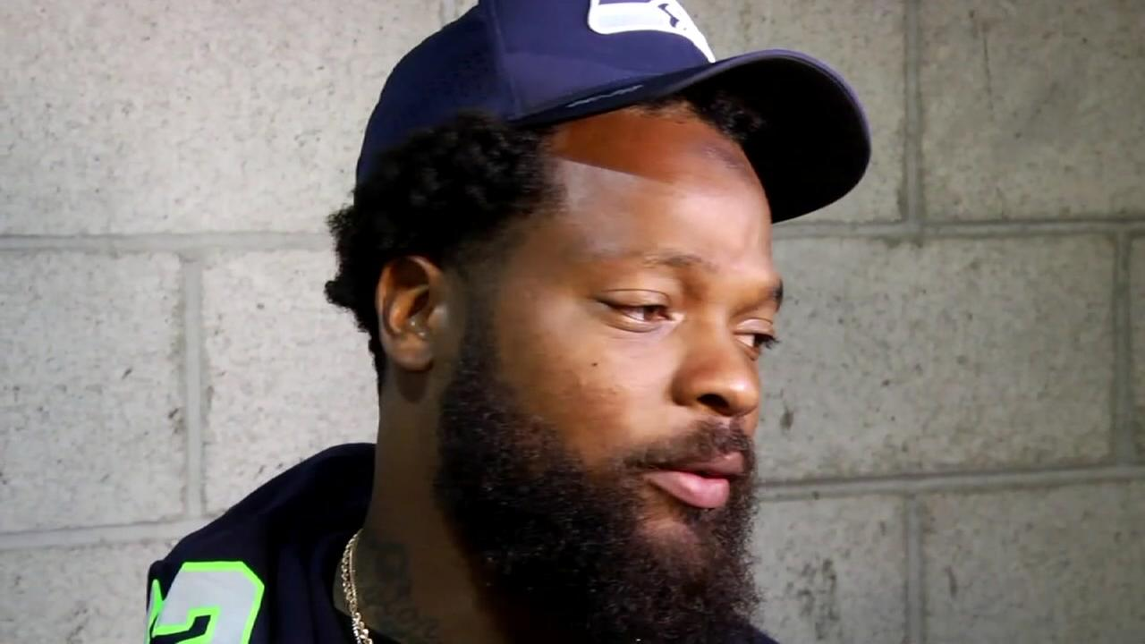 NFL player, Michael Bennett charged with injury to the elderly in incident at Super Bowl in Houston