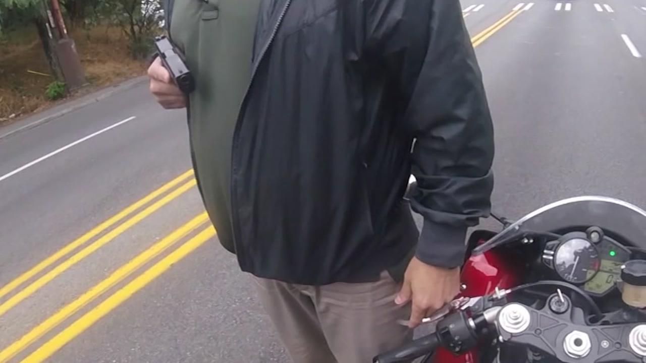 Detective pulls gun on motorcylist