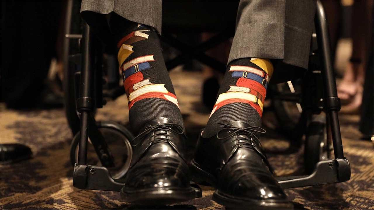 George H.W. Bush wears special books socks to honor the Barbara Bush Literacy Foundation