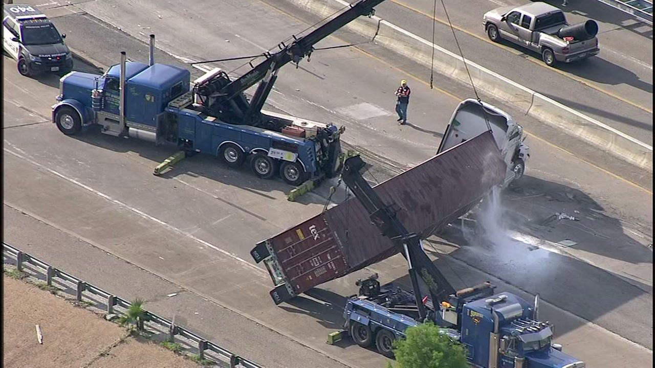 Big rig overturns on Hwy 225 and East Loop