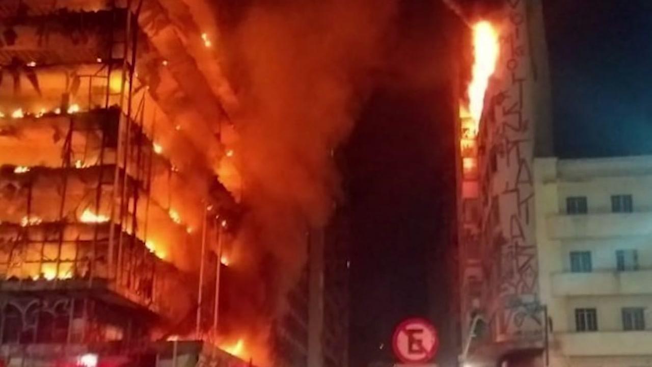 Huge fire brings down a high-rise