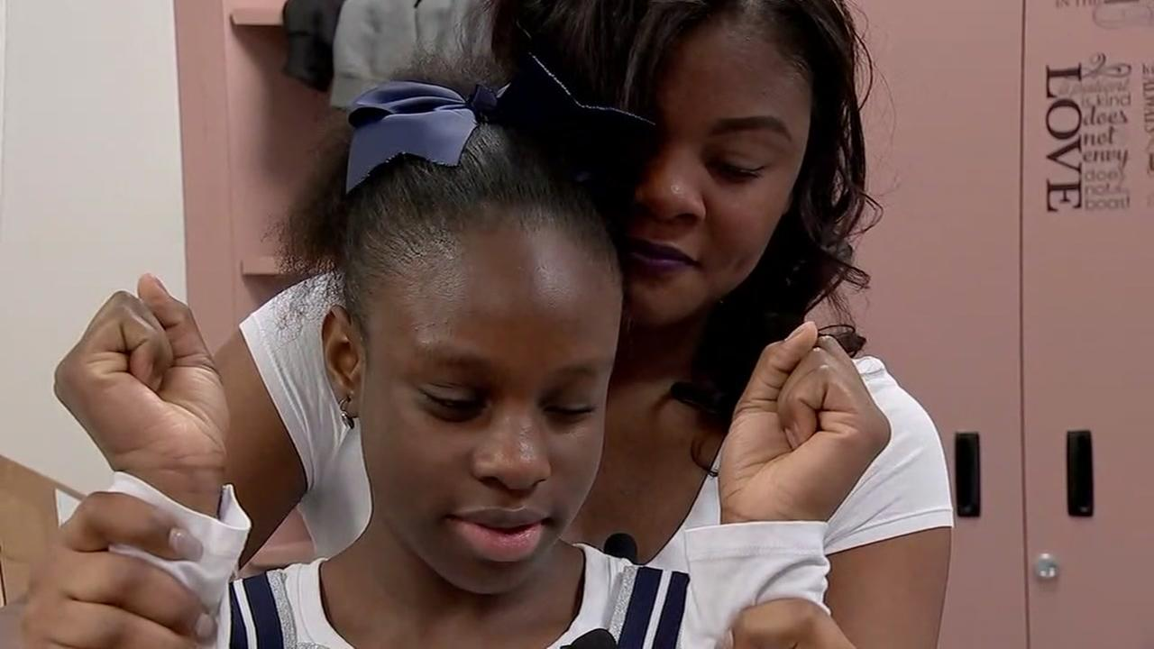 Alief teacher helps blind student become cheerleader
