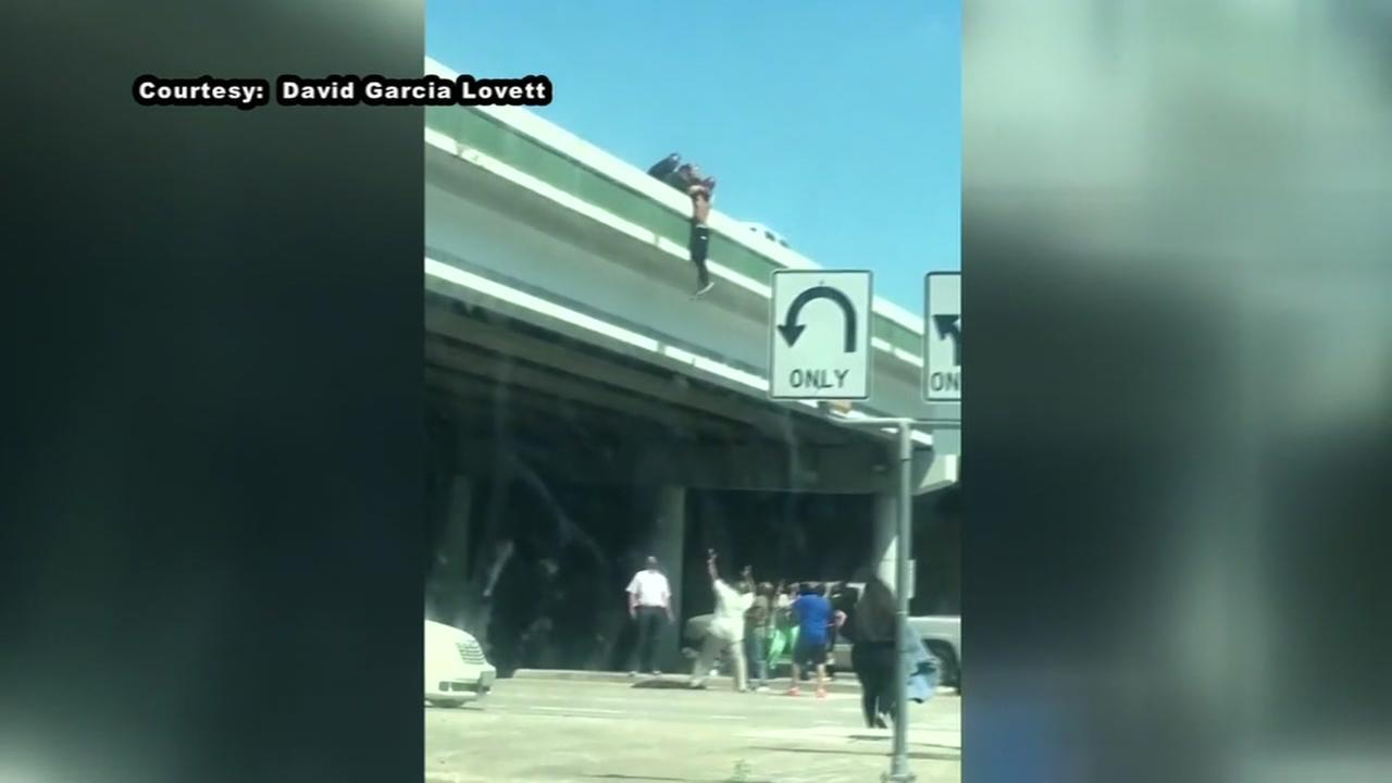 Heroes save dangling man