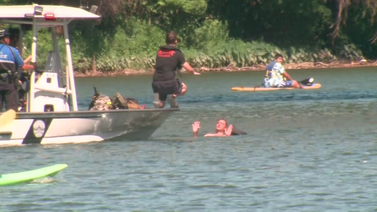 One man tries to elude police by jumping in a nearby lake