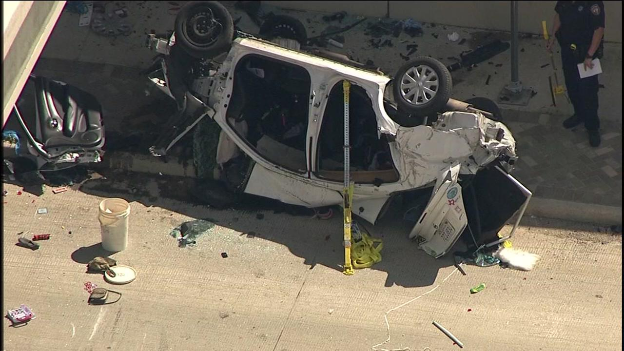 Car crashes off freeway overpass in northwest Harris County