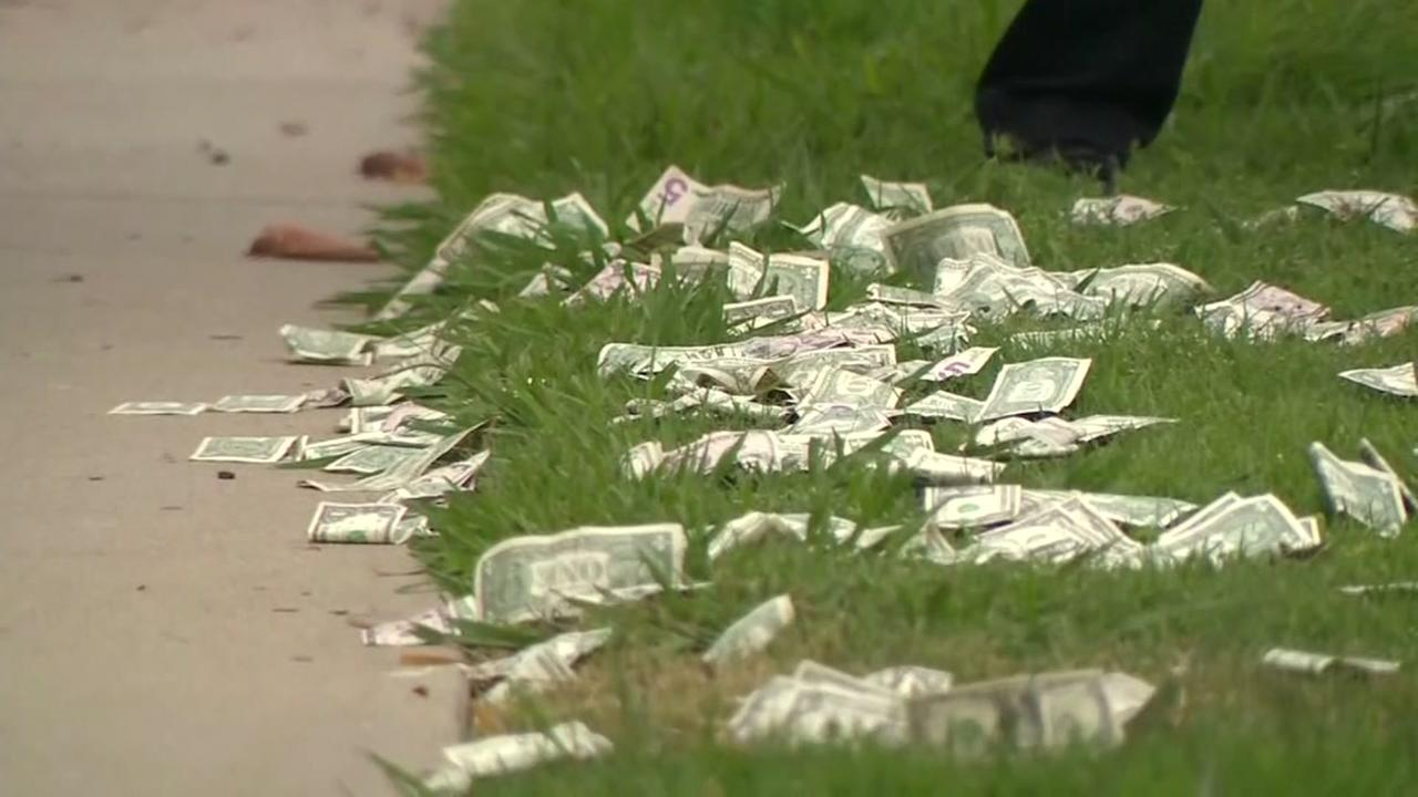Suspects throw money out of vehicle doing police chase