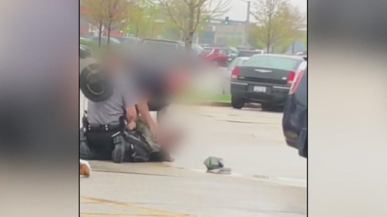Cell phone video appears to show a Wisconsin police officer punching a teen in the face