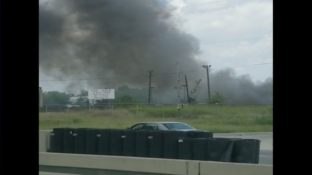 Massive fire breaks out at Husky Trailers on North Freeway