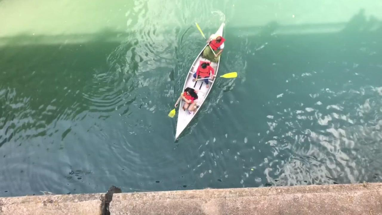 2 hospitalized after woman jumps from bridge onto Kayak