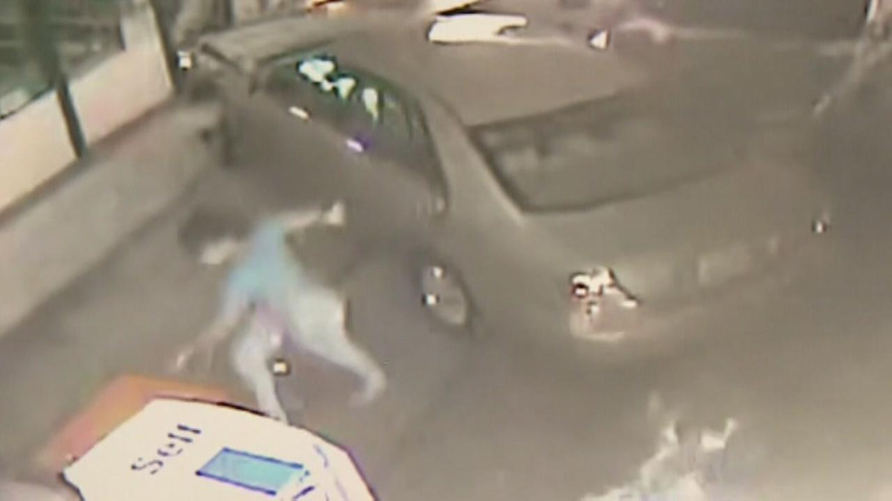 Car slams into gas station in fiery crash