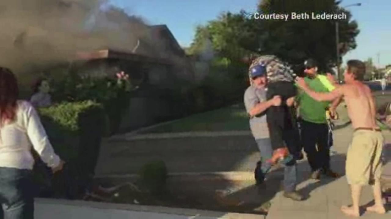 Man rescues stranger from burning home