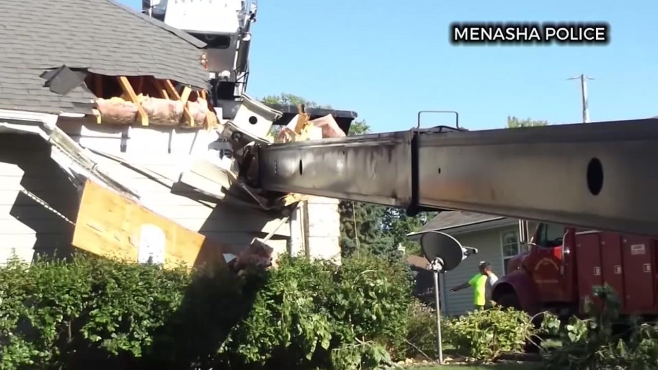 Crane smashed through home