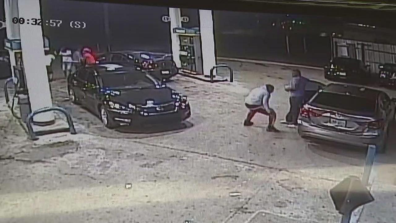 Surveillance feed of drive-by shooting that left four men injured