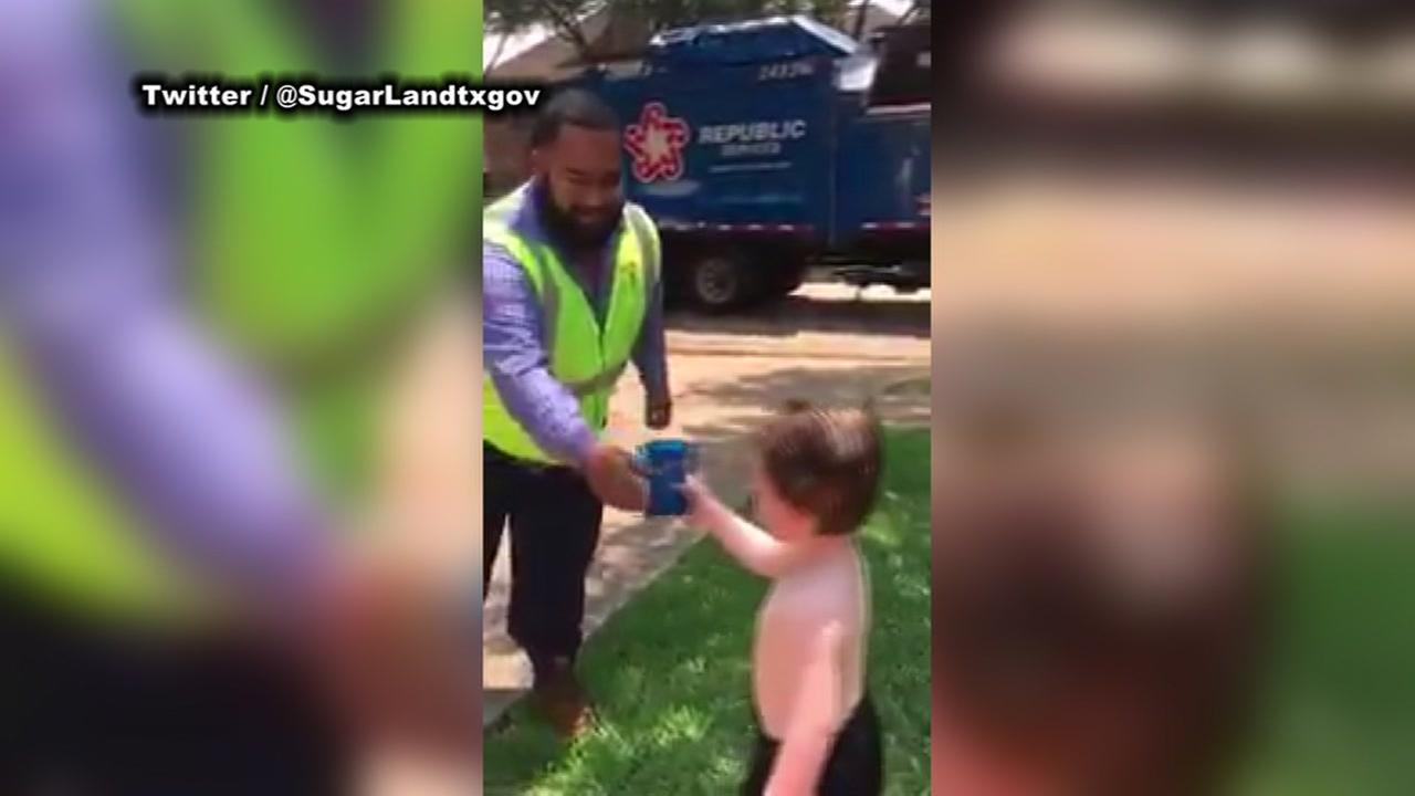 CUTE VIDEO: Garbage truck driver surprises kid with a toy