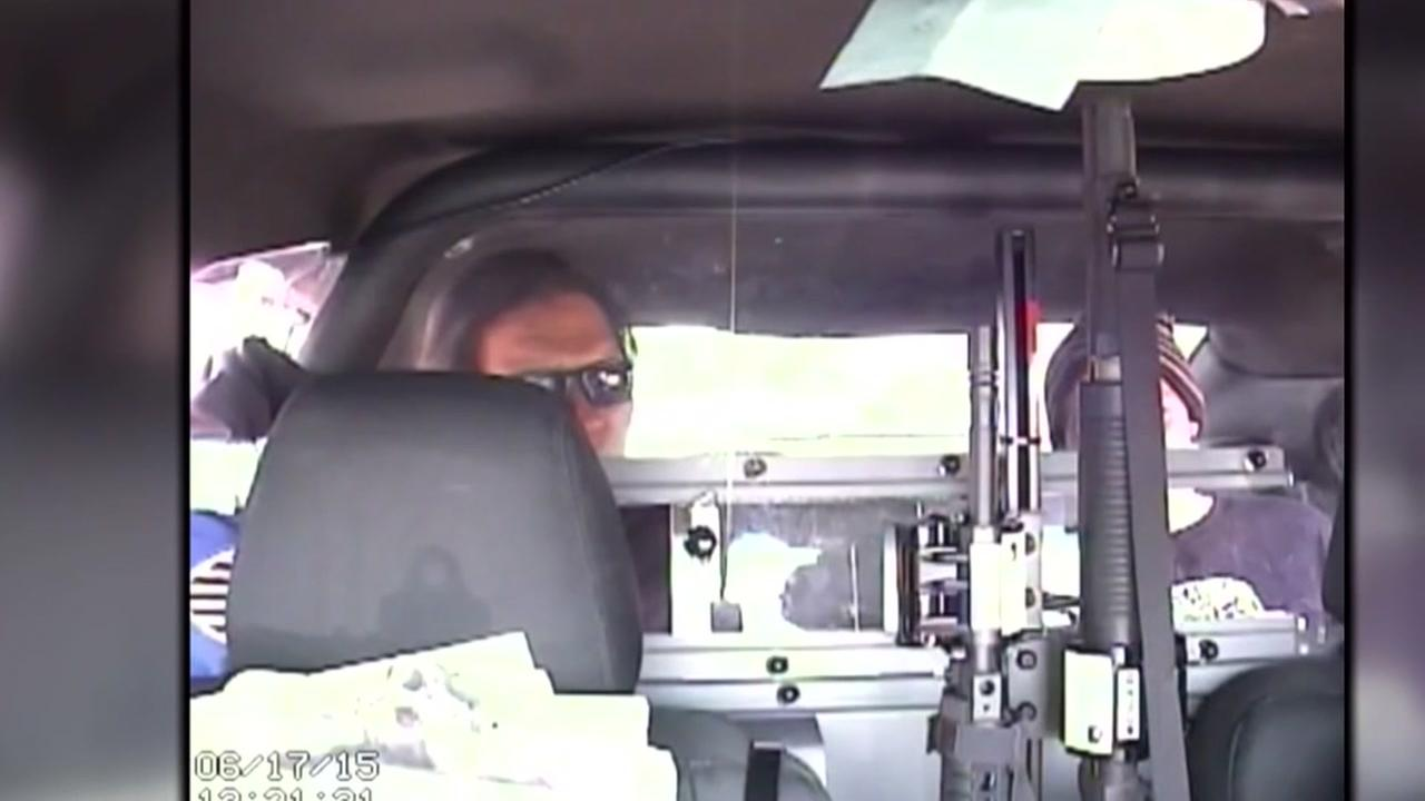 Officer sued for allegedly texting and driving