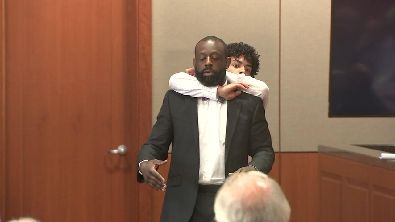 Witness demonstrates choke hold during deadly Dennys murder trial