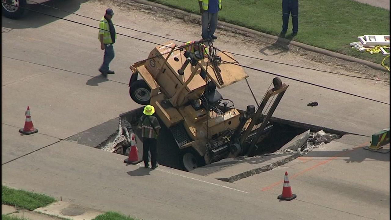 Construction vehicle falls into sinkhole in SW Houston