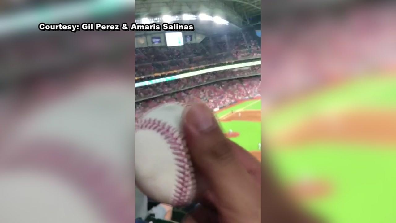 Fan stops foul ball from hitting woman in face