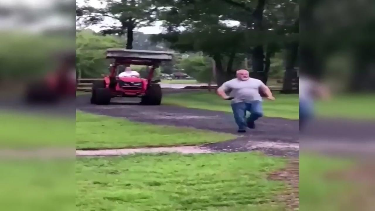 Tractor Going Right On Man : Calls florida man chases neighbor with tractor over
