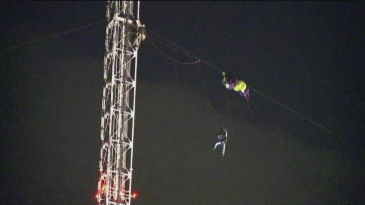 Parachutist stuck on radio tower