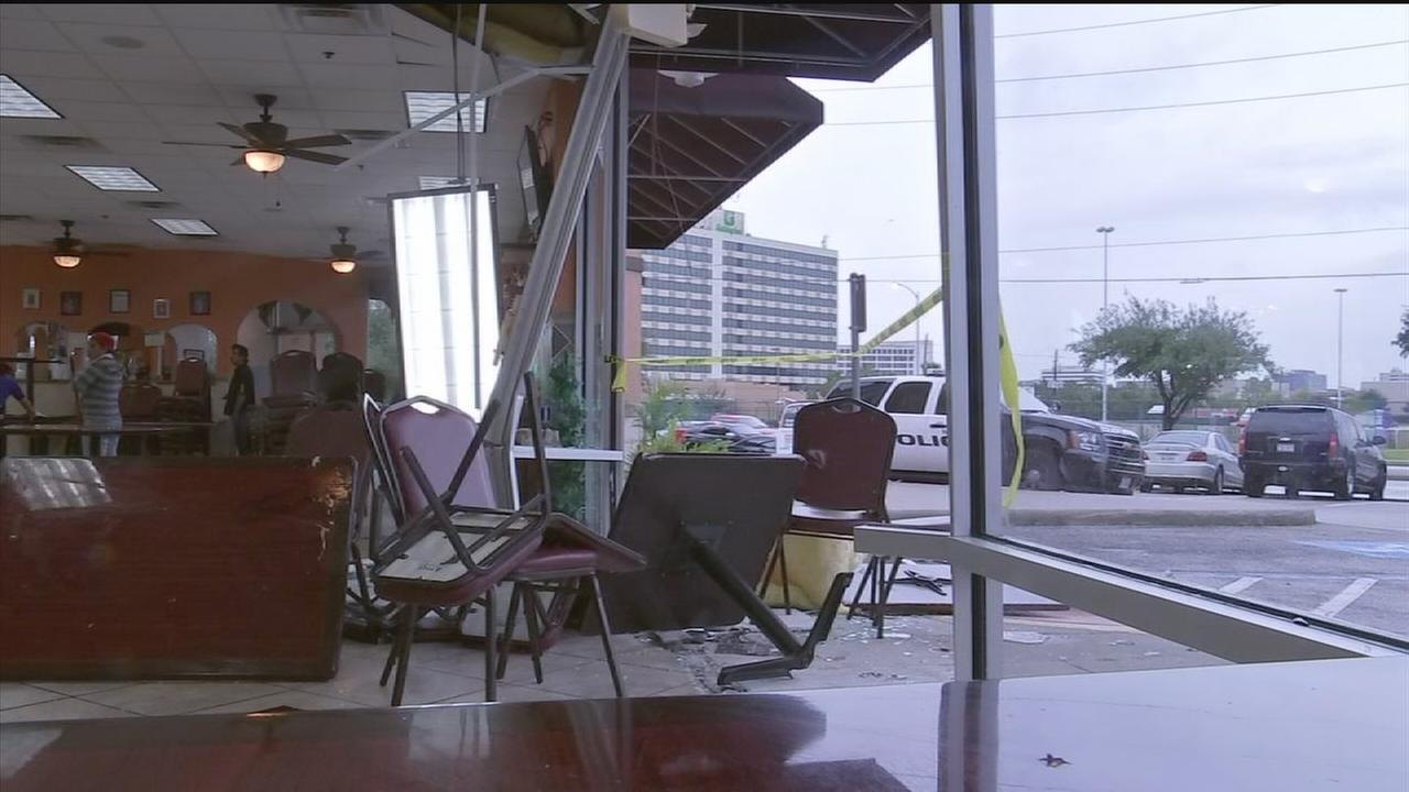 Questions linger after car crashes into restaurant