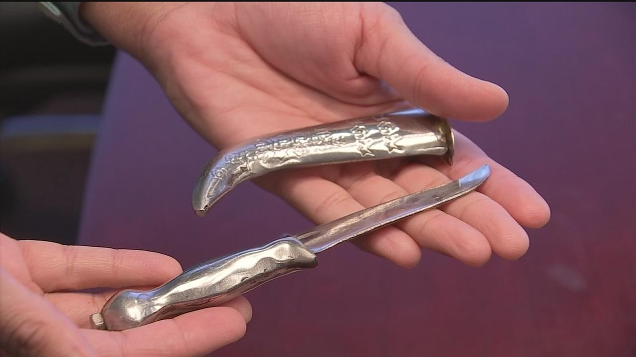 Woman loses job over religious knife, wins lawsuit