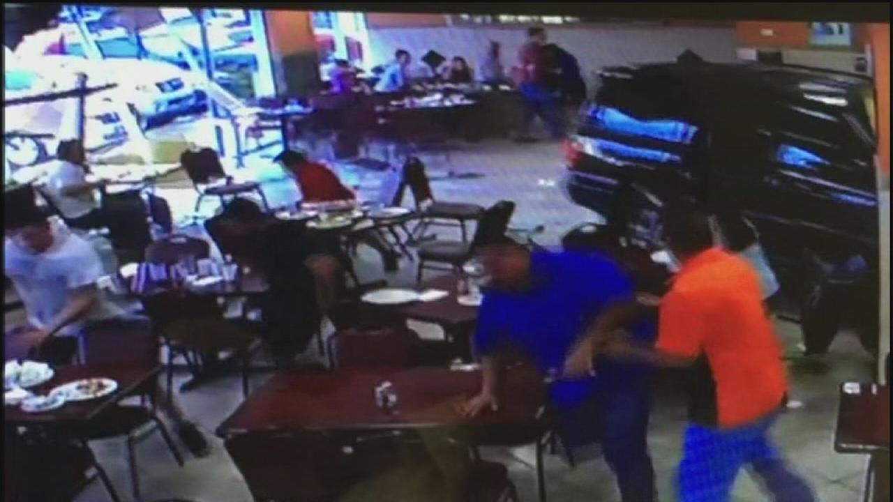 Woman who drove SUV into restaurant faces lawsuit