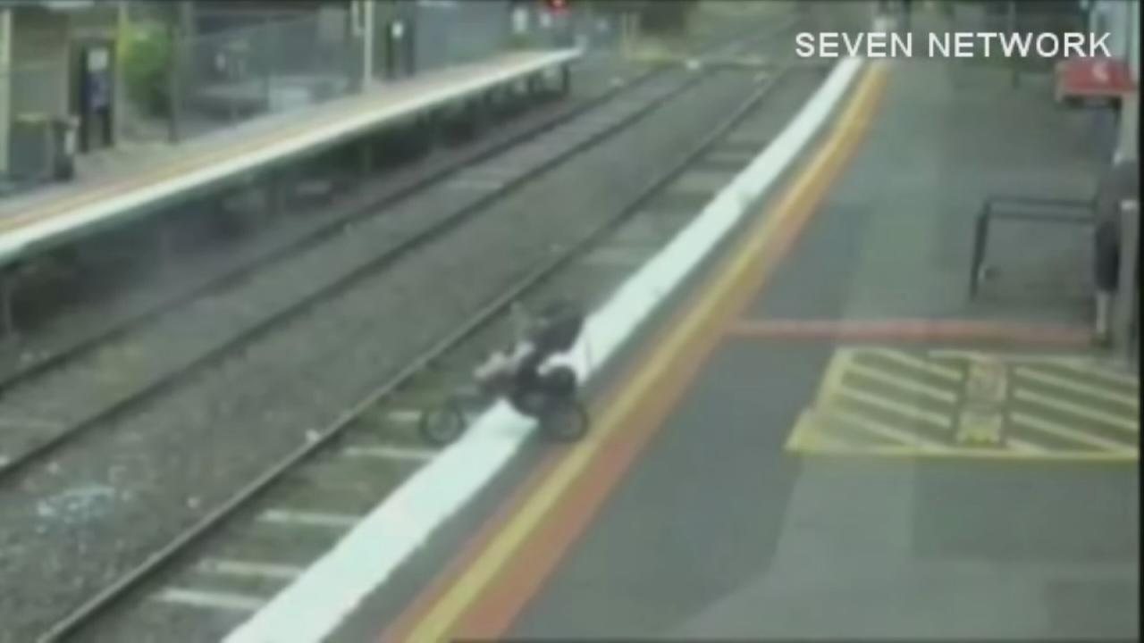 Dramatic surveillance video of stroller on train tracks