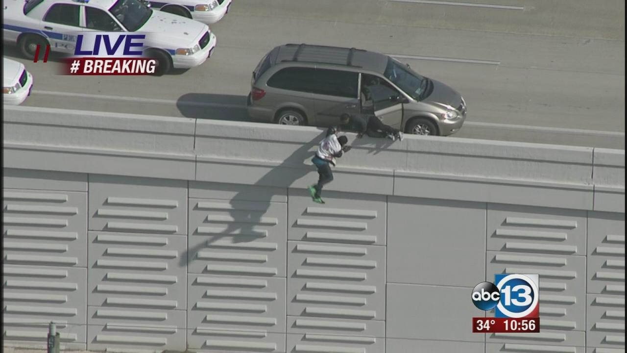 People jump from freeway at  end of chase