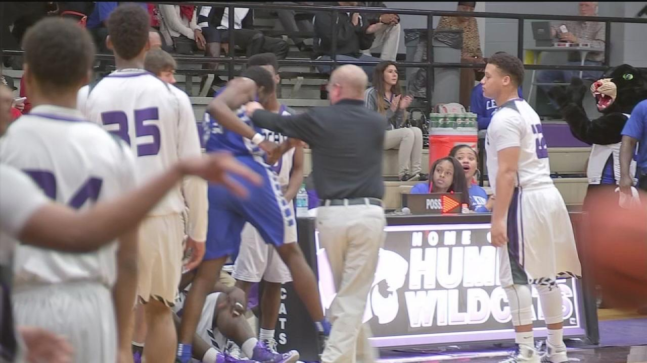 Coach caught on camera shoving player