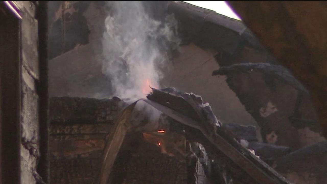 Two-alarm fire destroys apartment units