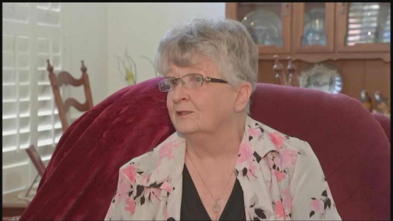 Elderly woman warns against scammers using scare tactics