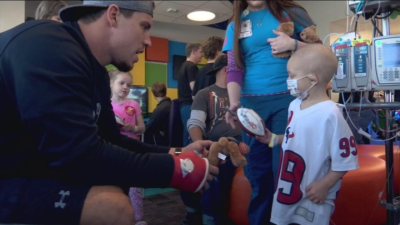 Texans players surprise kids at Texas Childrens Hospital