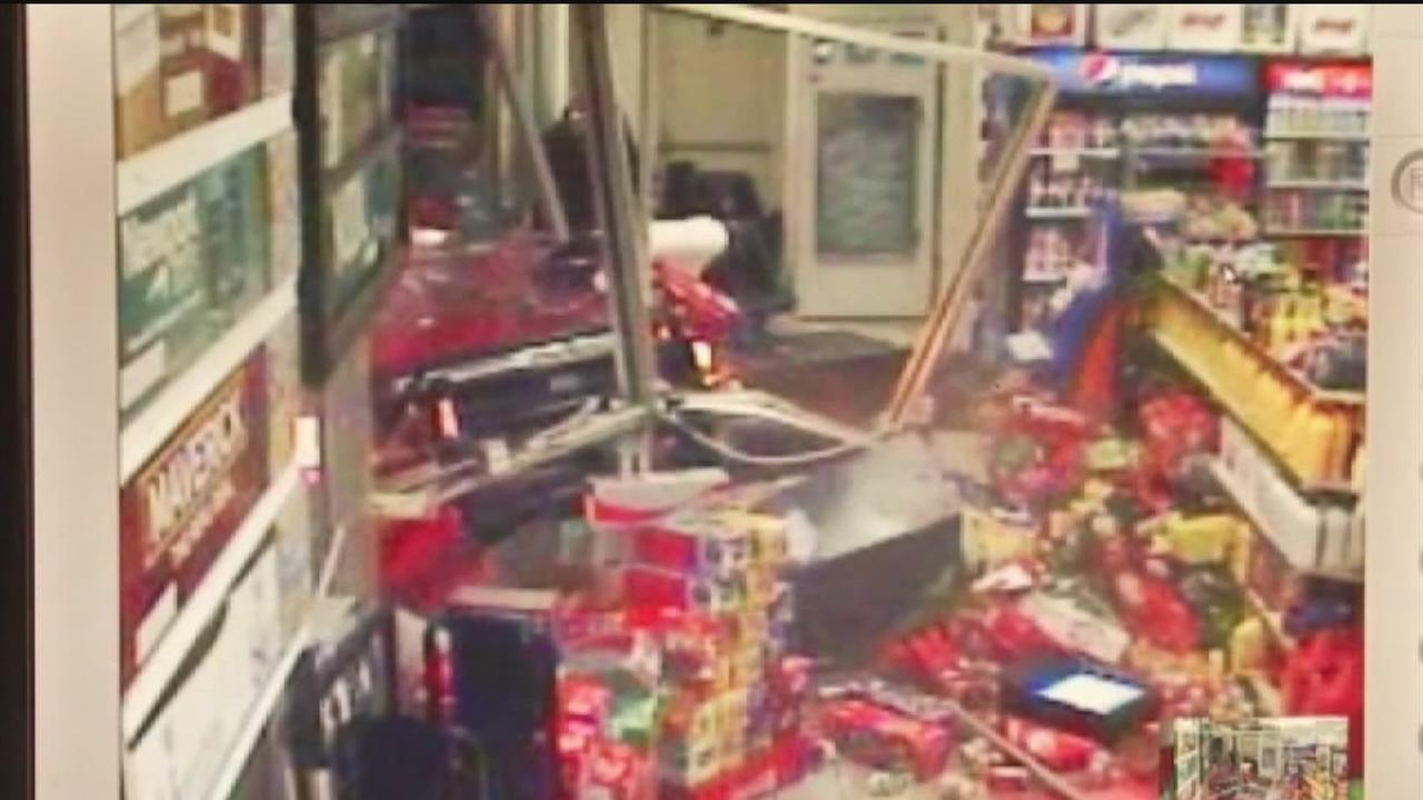 Woman hospitalized after burglars smash into store