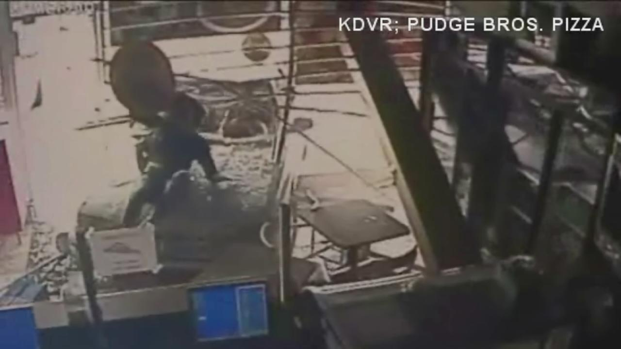 Car plows into Colorado pizza shop with woman on hood