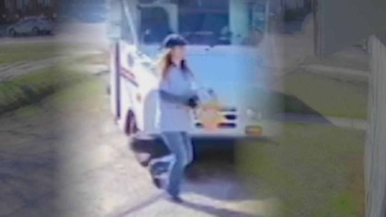 USPS worker caught on camera tossing package