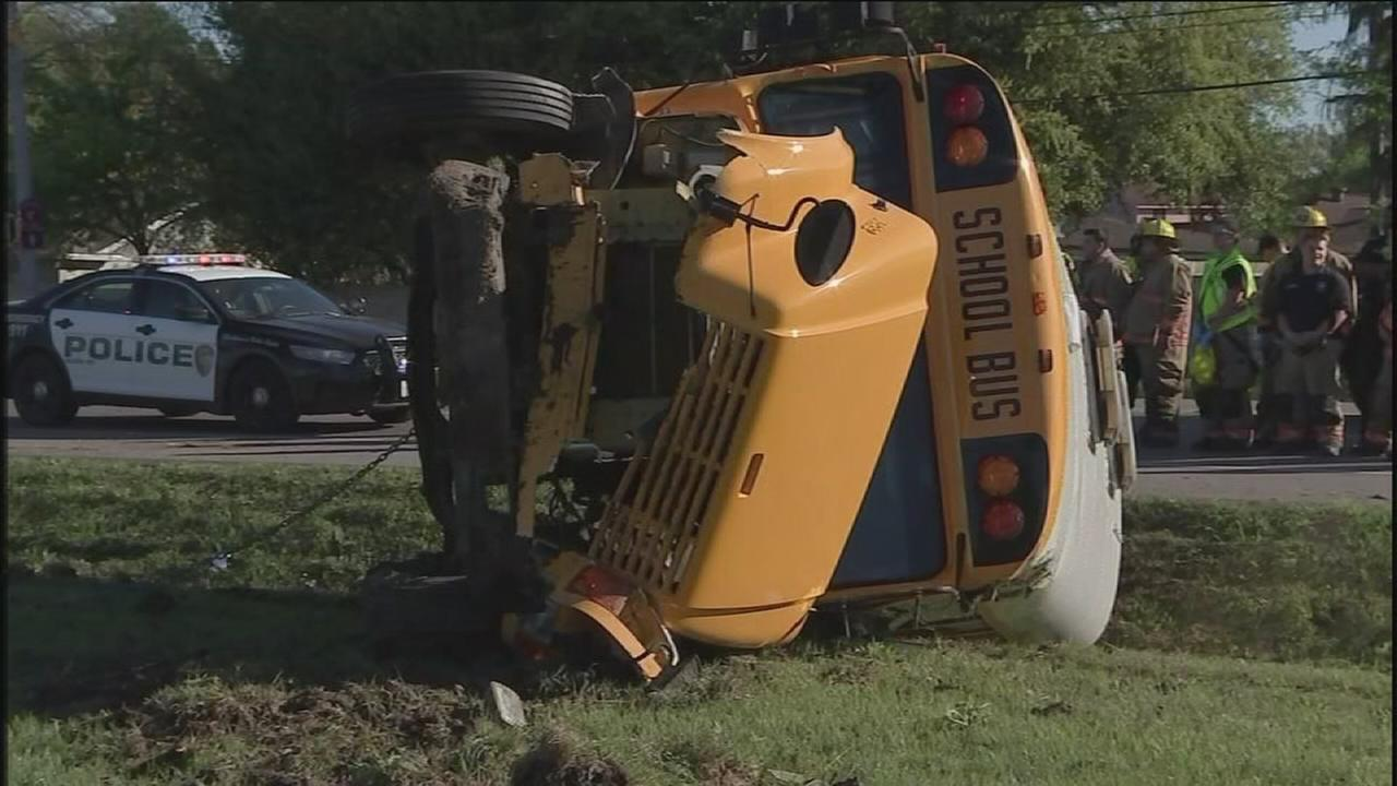 School bus overturns with students inside