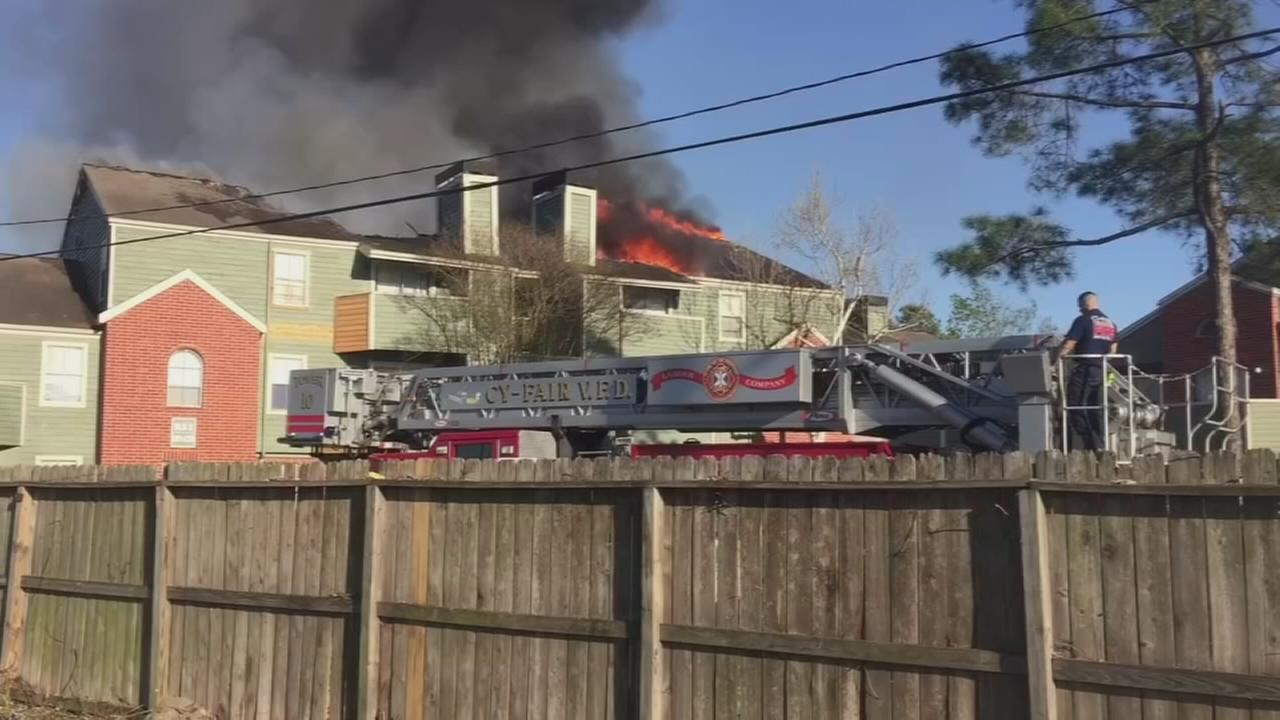 Fire burns at apartments in NW Harris Co.