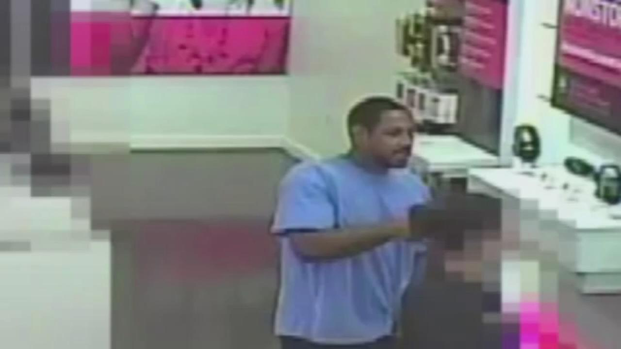 Suspect sought in phone store theft