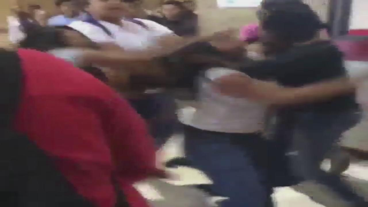 Teen, parent fight at high school caught on video