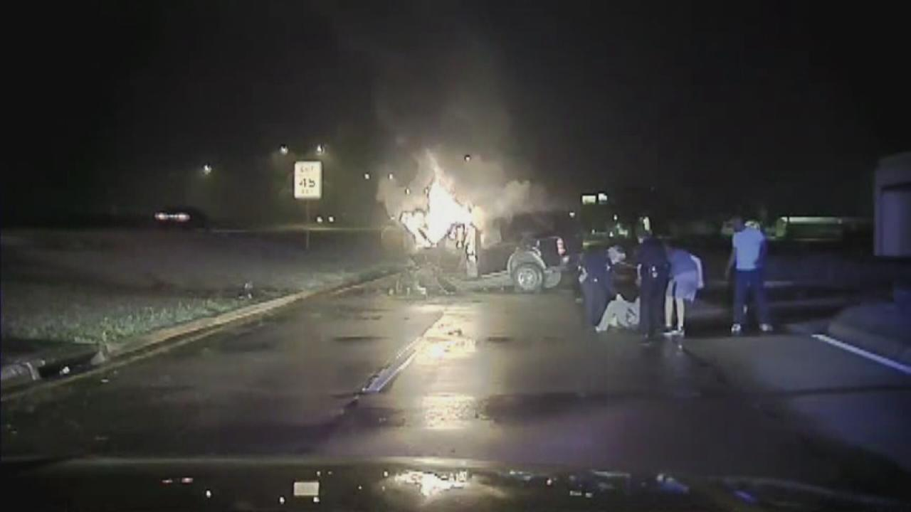 Police rescue driver from fiery wreck