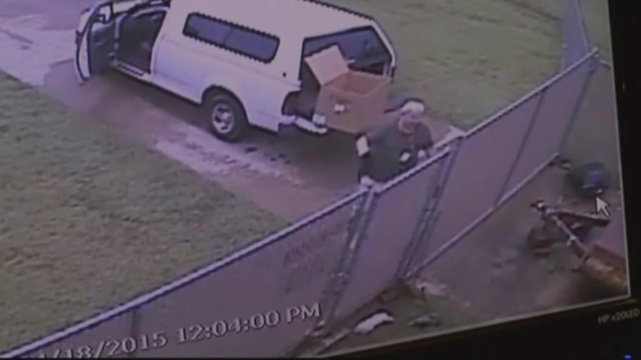 School worker caught on camera tossing puppies over fense