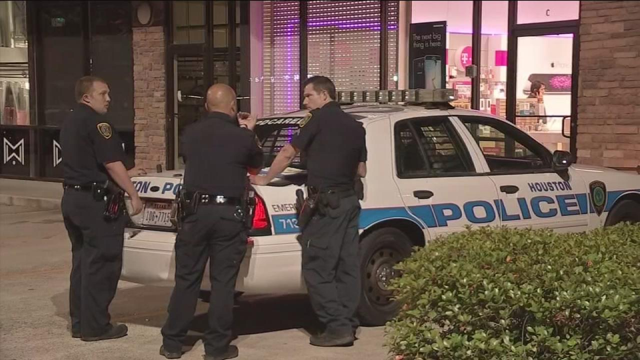 Two gunmen arrested after cell phone store attack