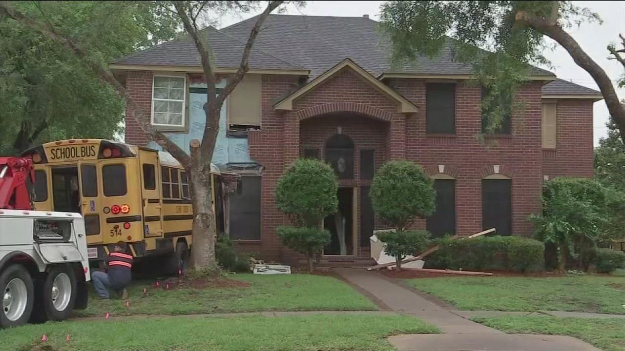 Bus crashes into home, injures 3 people