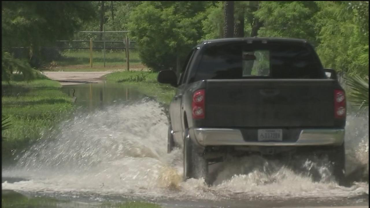 Water rising along San Jacinto River
