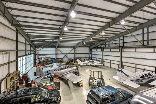 <div class='meta'><div class='origin-logo' data-origin='none'></div><span class='caption-text' data-credit='PHOTOS COURTESY OF Wade Blissard'>This Spring dwelling is half hangar, half home and an aviator's dream!</span></div>