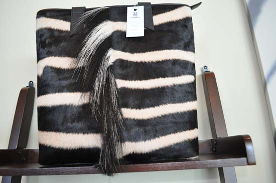 "<div class=""meta image-caption""><div class=""origin-logo origin-image none""><span>none</span></div><span class=""caption-text"">Zebra Hide Purse: $990</span></div>"