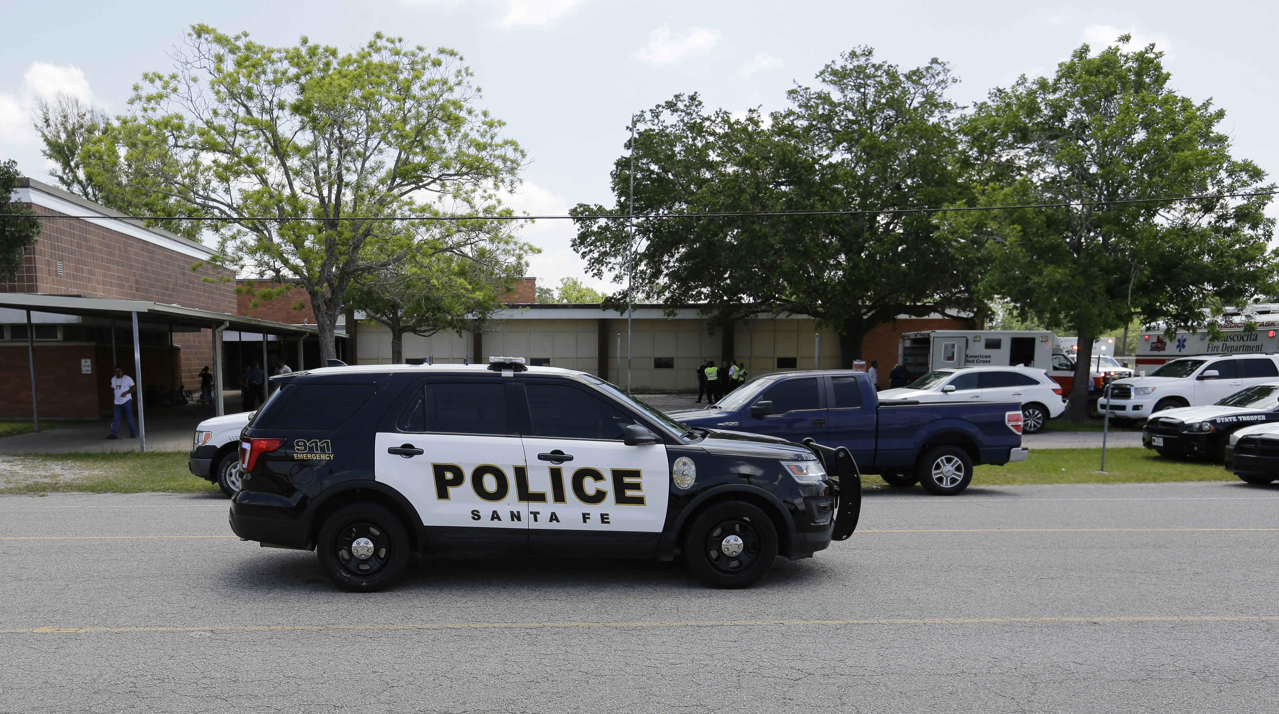 <div class='meta'><div class='origin-logo' data-origin='AP'></div><span class='caption-text' data-credit='AP'>Police cars are parked outside the Alamo Gym where students and parents wait to reunite following a shooting at Santa Fe High School, May 18, 2018. (AP Photo/David J. Phillip)</span></div>